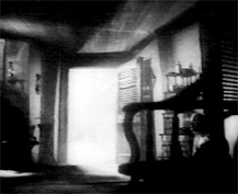 Helen Hayes dying (behind interstices of foreground chair)