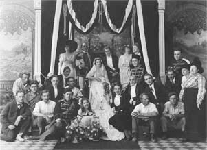 Grace Cunard on throne, beside Francis Ford. Second row left: Jack Ford. 1915.