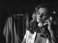 Halloween: Annie calls Laurie as Myers approaches from behind wrapped in a bed sheet. Here too the victim is trapped between the telephone and the disappearing Other