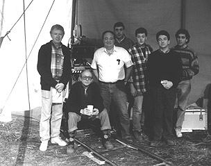 "A camera crew photo from Shadows and Fog. From left to right: Ronald ""Red"" Burke (Dolly Grip), Carlo DiPalma, Richard Mingalone (Camera Operator), Michael Caracciolo (2nd Assistant Camera), David Baron (Film Loader), Brian Hammill (Still Photographer), and Michael Green (1st Assistant Camera). Photo courtesy of David Baron."