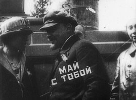 "Lenin in Kino–Pravda 21 (the writing on his sleeve says ""May is with you"")"
