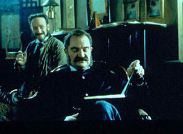 Gilbert (Jim Broadbent) reads a first draft of The Mikado to Sullivan (Alan Corduner); the partnership is reborn.