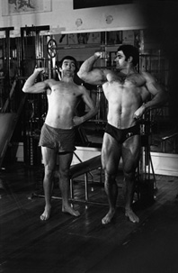 Graeme Blundell (the market researcher) joins instructor Peter McCarthy at Frank Findlay's gymnasium for a scene in The Naked Bunyip