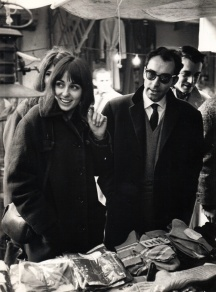 Jean-Luc Godard with Charles Bitsch, Geneviève Galéa, and Catherine Ribeiro (behind), looking for costumes for Les Carabiniers at a flea-market. Photo: Amleto Calzolari.