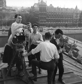 Jacques Rivette, with Jean Herman, unknown man, Charles Bitsch (in profile) and André Mrugalski, on the roof of the Sarah Bernhardt Theatre, during the shoot of Paris nous appartient, 1958. Photo: Georges Pierre.