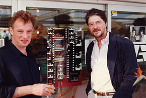 Ken McMullen (camera left) with John Cartwright of the British Council, outside the British Pavilion at Cannes, 1990, when 1871 was an official selection. Photo: James Leahy.