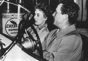 "Mike Hammer (Ralph Meeker) and Christina (Cloris Leachman) in his ""pretty little car"" in Kiss Me Deadly"