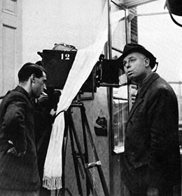 Jean Renoir (right) and cameraman Curt Courant shooting La Bête humaine. They are in the fragment of the set of the Roubauds' apartment which Lourié had built overlooking the marshalling yards at Le Havre