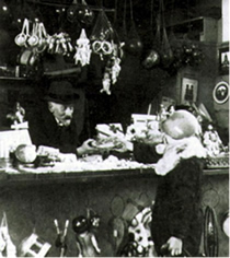Méliès working in a toy kiosk