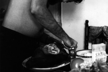 Albie Thoms carving a turkey, Goodhope Street, Sydney, 1966 (Photo: Aggy Read)