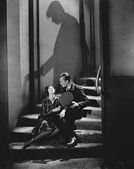 Nora Baring, Brian Aherne and Cyril McLaglen's shadow in Underground