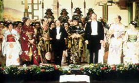 Sullivan (left) and Gilbert (right) accept the adulation of the crowd on the opening night of The Mikado.
