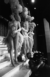 Dancers at The Lido, Melbourne, prepare for a scene in The Naked Bunyip. Bruce McNaughton (DOP) sits at their feet, readying to shoot.
