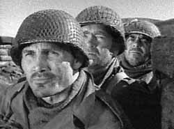 Lt. Costa (Jack Palance), Sgt. Tolliver (Buddy Ebsen) and Pfc. Bernstein (Robert Strauss) observe a possible enemy position in Attack!